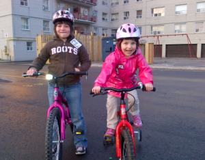 My first wheels, boy and girl on bikes. Spynga Toronto
